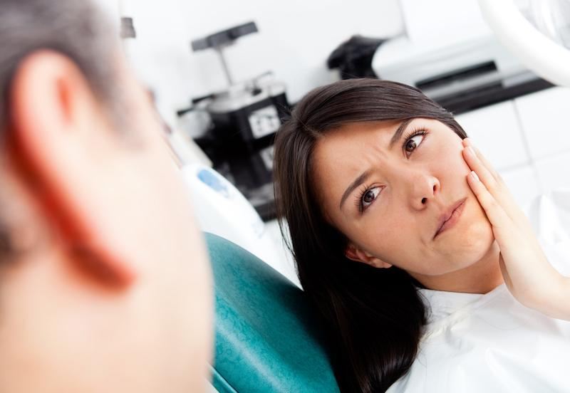 A Woman Looks At The Dentist With Concern | Root Canal Treatment St. Paul, MN