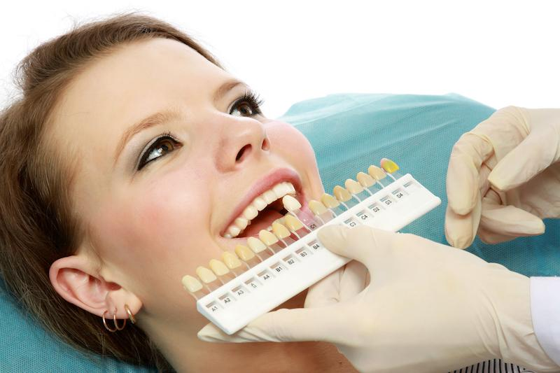 A Woman Is Worked On By The Dentist | Professional Teeth Whitening St. Paul, MN