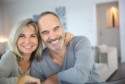A Couple Smiling | Dental Implant Restoration in St. Paul, MN