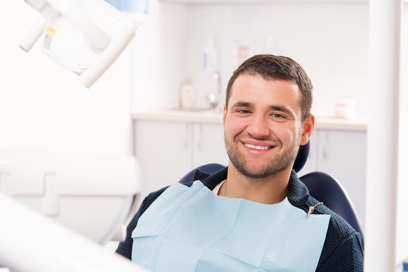 A Man Smiles In The Dental Chair | Pain-Free Dentistry St. Paul, MN