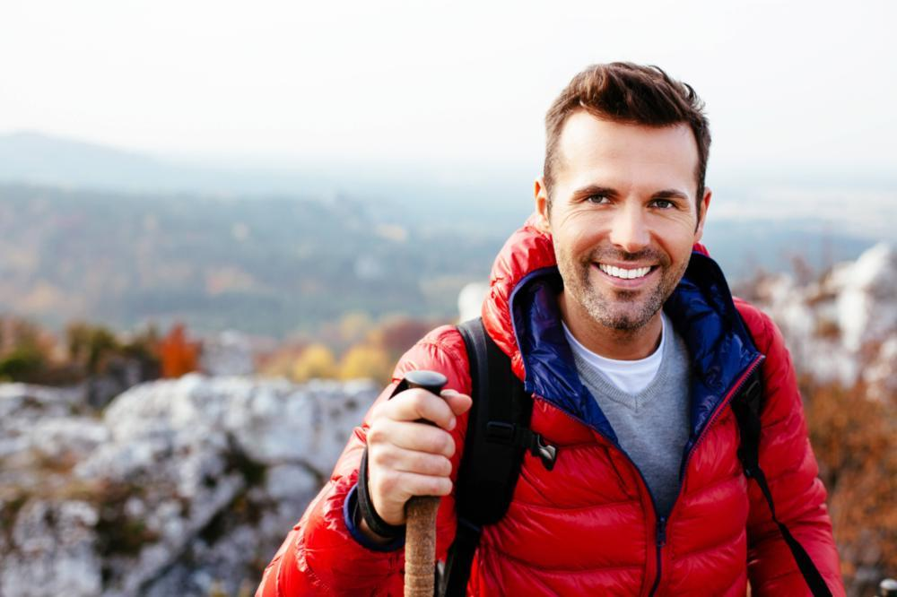 a man smiles as he hikes | sedation dentistry in St. Paul, MN