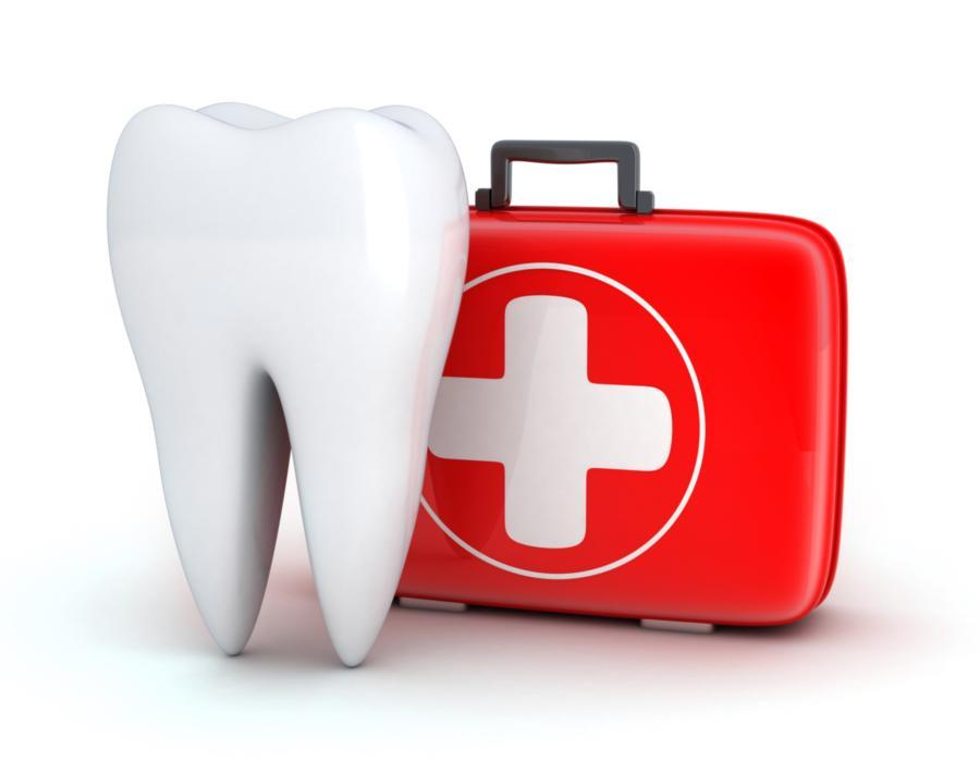 An image of a tooth and a first aid kit | Dental Emergencies St. Paul
