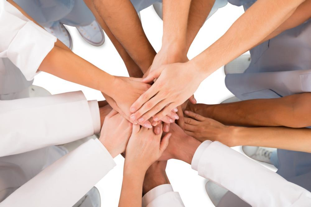 a group of hands in a circle | St. Paul dentist