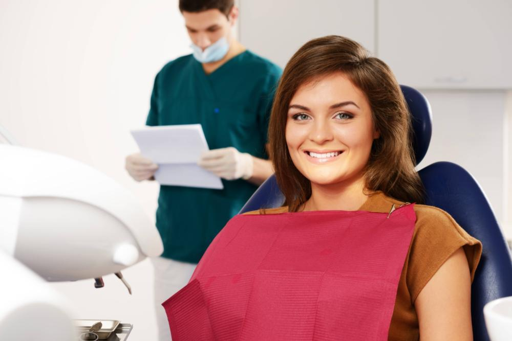 a woman sits in the dental chair | sedation dentist St. Paul, MN