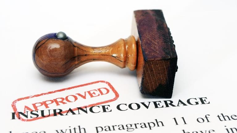 an image of a stamp laying on insurance papers | family dentistry st paul