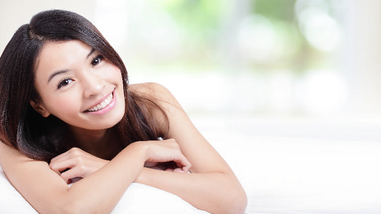 A woman smiles | dental veneers st. paul mn