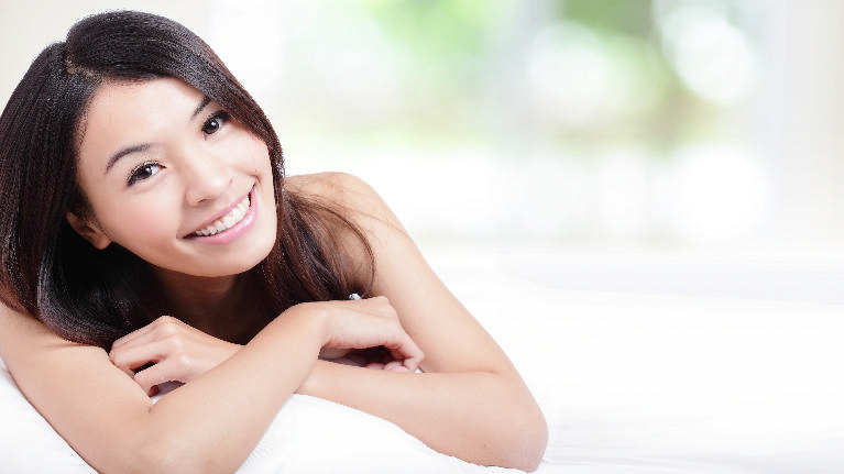 a woman smiles | dental implants St. Paul