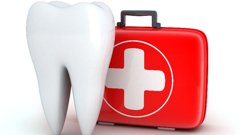 a tooth in front of a first aid kit | st. paul MN emergency dentist